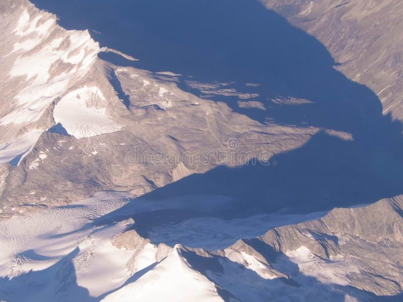 Alpen van het vliegtuigvenster stock foto