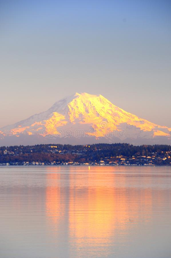 Alpenglow on Mount Rainier reflects on Puget Sound royalty free stock photos