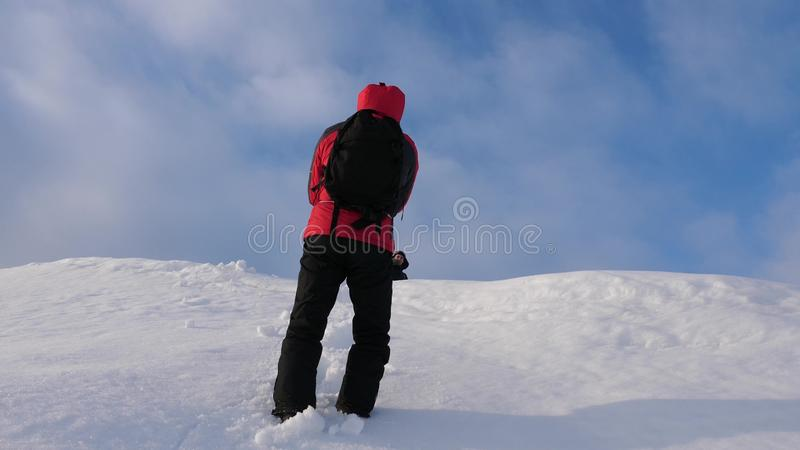 Alpenists team in winter down rope from mountain. Travelers descend by rope from a snowy hill. well-coordinated teamwork. Alpenists team in winter down rope from royalty free stock images