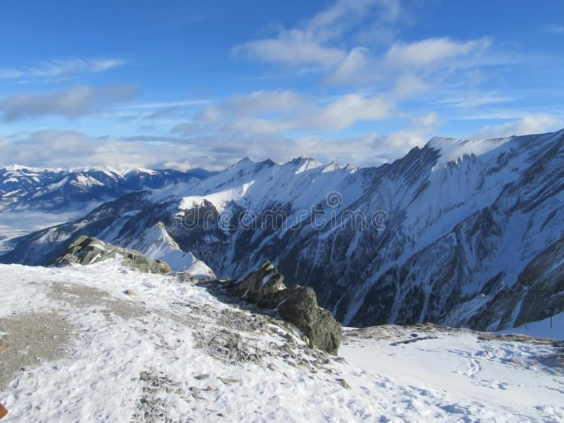 Alpes ski resort slopes, mountain panorama and sun aerial view, stock image