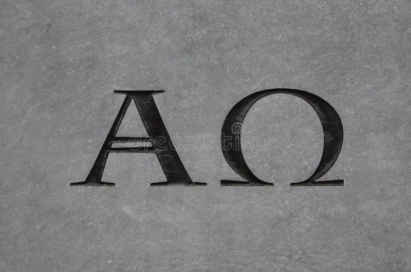 Alpha- en Omega in steen royalty-vrije stock fotografie