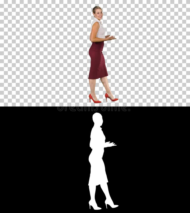 Business woman strongly going forward and talking to camera, Alpha Channel royalty free stock image