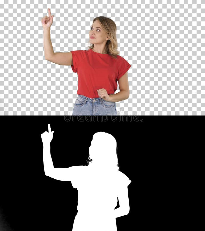 Happy young woman showing a product pointing with her finger to sides Presentation, Alpha Channel stock image