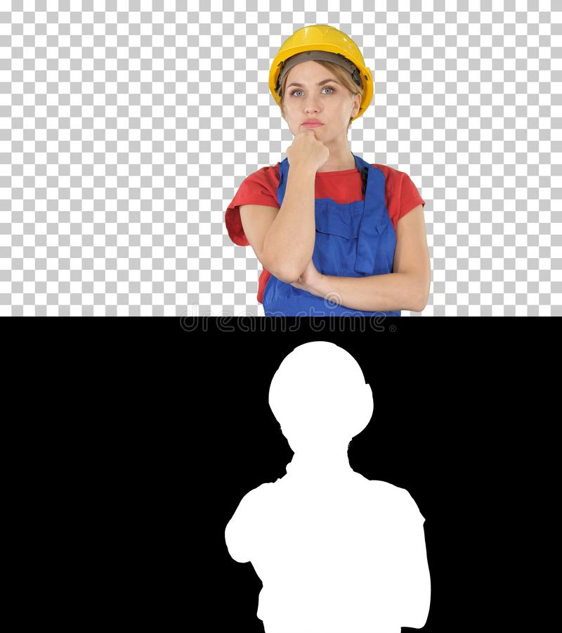 Thinking construction worker woman wearing builder helmet, Alpha Channel stock images