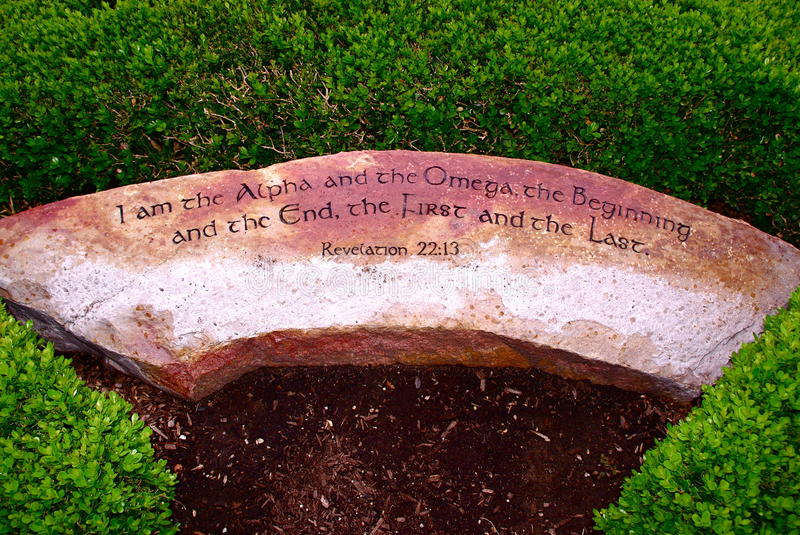 Alpha & Omega Revelation Engraved Rock. A stone engraved with the Bible scripture Revelation 22:13 : I am the Alpha & Omega, the beginning and the end, the first stock photos