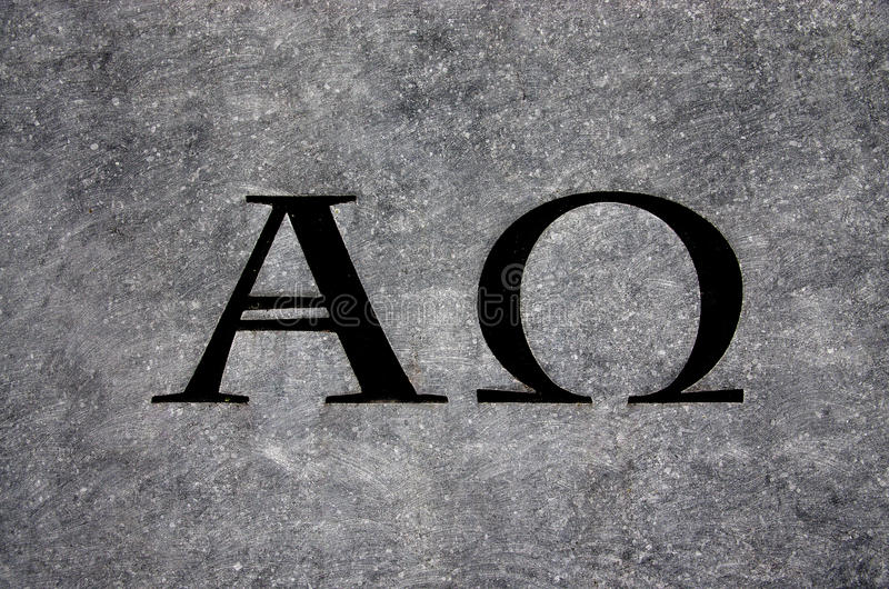 Alpha and Omega in stone. A photo of the Alpha and Omega in stone stock photo