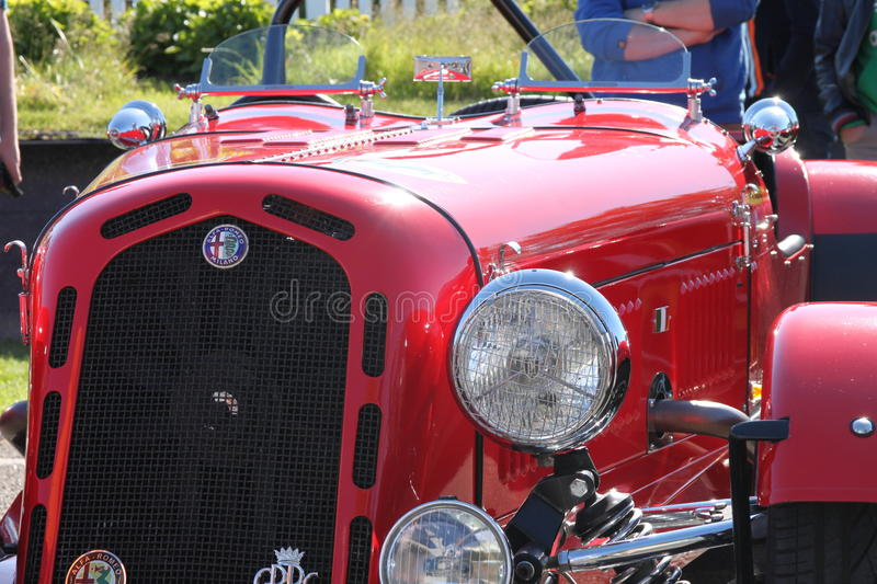 Alpha Romeo 6C sports car red Mid 1930`s front detail. Alpha Romeo 6C Italian classic sports car Mid 1930`s front detail. Headlamp and grille stock photography