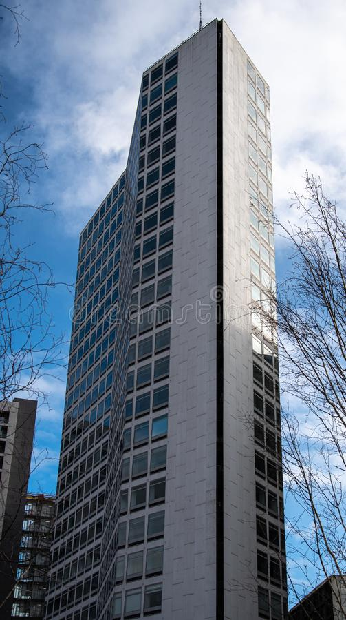 Alpha Tower Birmingham. Birmingham, England - March 17 2019:   The modern landmark of Alpha Tower reaches into the Birmingham Skies above Paradise Circus royalty free stock image