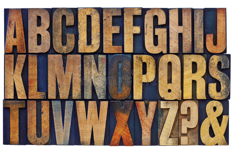 Alphabet abstract. Akphabet abstract - 26 letters, question mark and ampersand - vintage letterpress wood type printing blocks stained by color inks stock photos