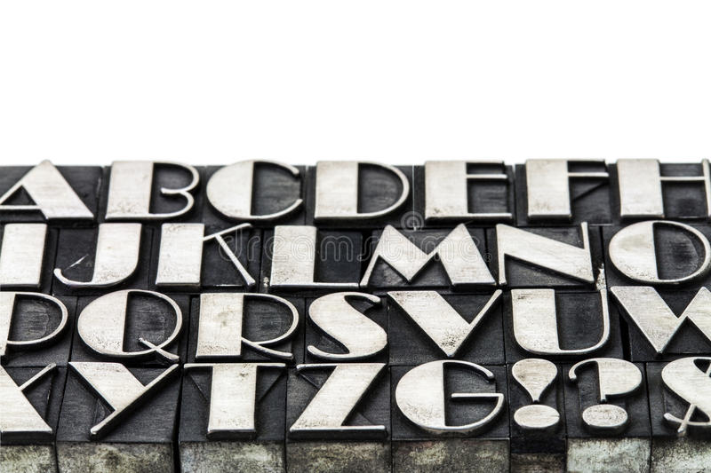 Alphabet abstract in metal type stock images