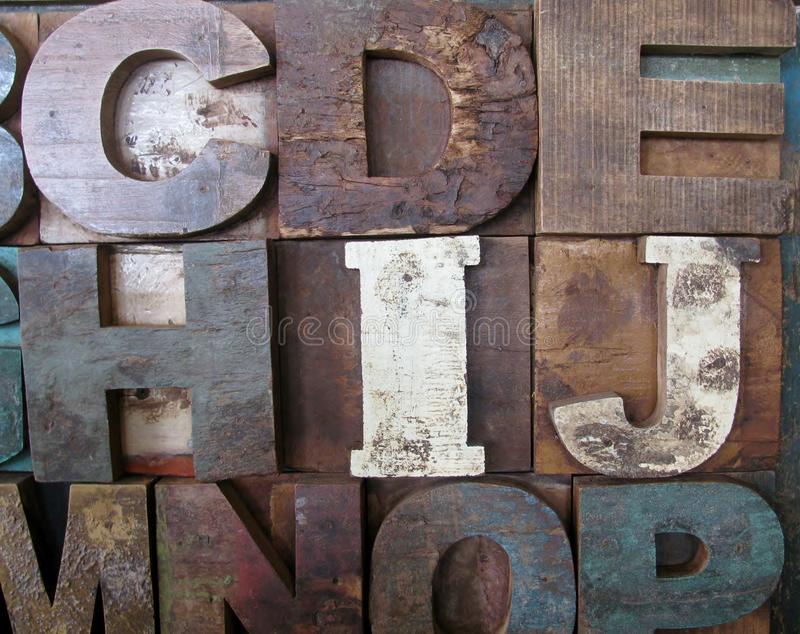 Alphabet abstract - vintage wooden letterpress types. C, D, E, H, I and J letters royalty free stock photography