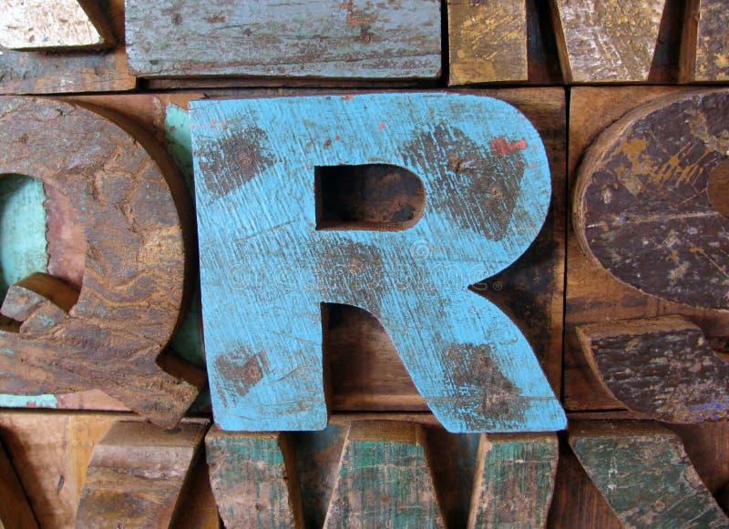 Alphabet abstract - vintage wooden letterpress types. Letter R. Alphabet abstract - vintage wooden letterpress types. Letter R painted blue color stock photos