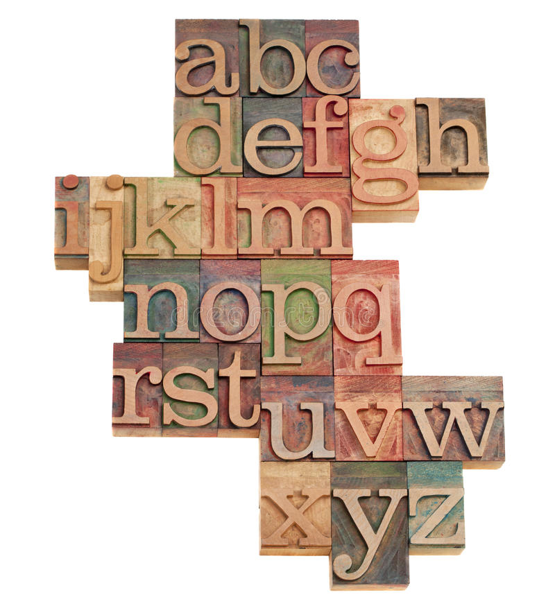 Alphabet abstract in wooden fonts. Alphabet - abstract of vintage wooden letterpress printing blocks stained by color inks, isolated on white stock image