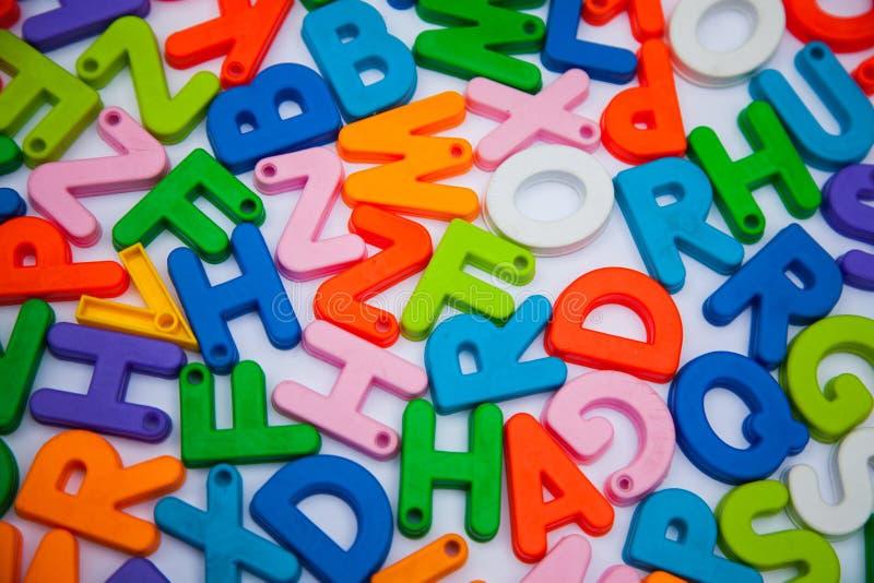 Alphabet blocks placed randomly. Welcome written alphabet blocks paper greet greetingn greetings welcomer placed randomly learn teach learning royalty free stock photo