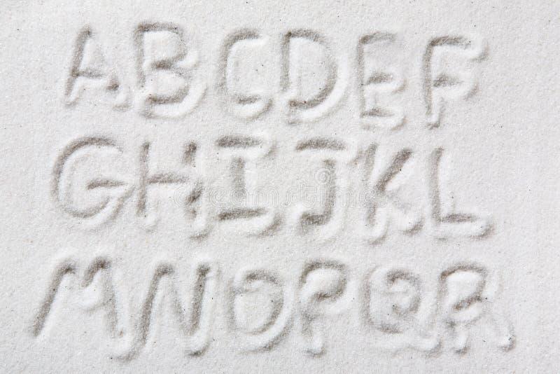 Alphabet de sable photos stock