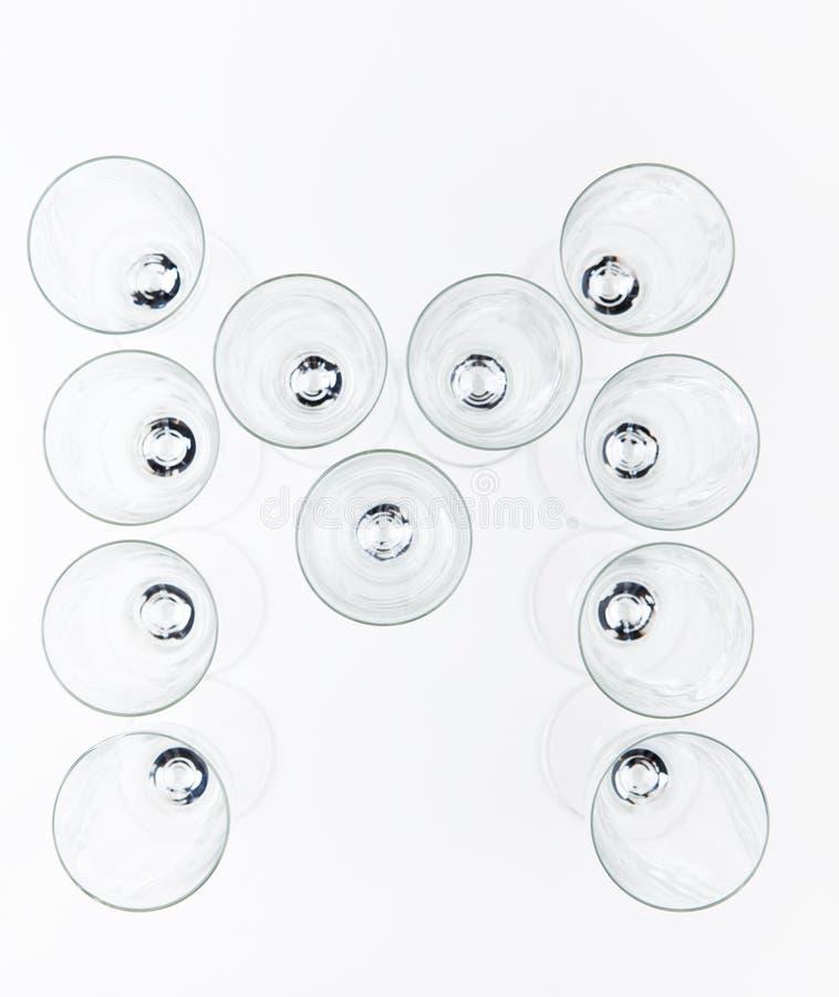 Alphabet Empty champagne glass white background royalty free stock photo
