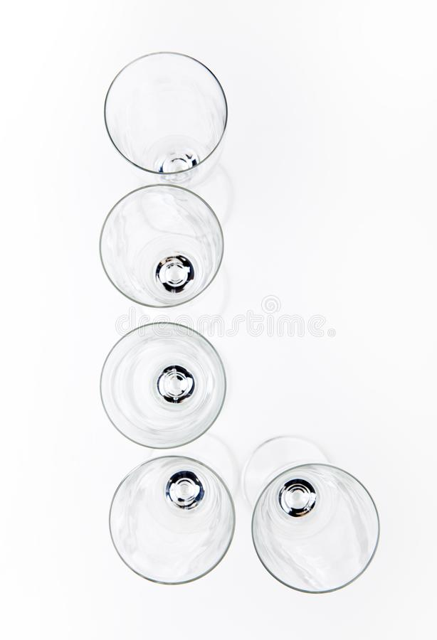 Alphabet Empty champagne glass white background stock photos