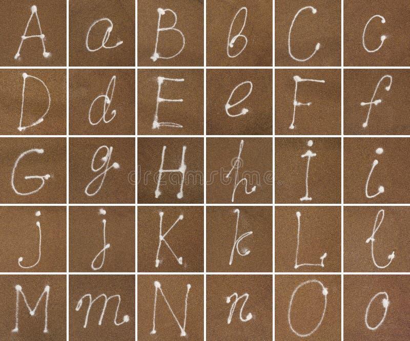 Alphabet en sable d'A à O image libre de droits