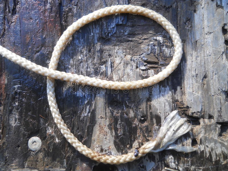 Alphabet Letter E Rustic Western Rope. Alphabet letter e is formed with an rustic rope. Letters can stand alone or linked together to form words.Wooden board is stock photos