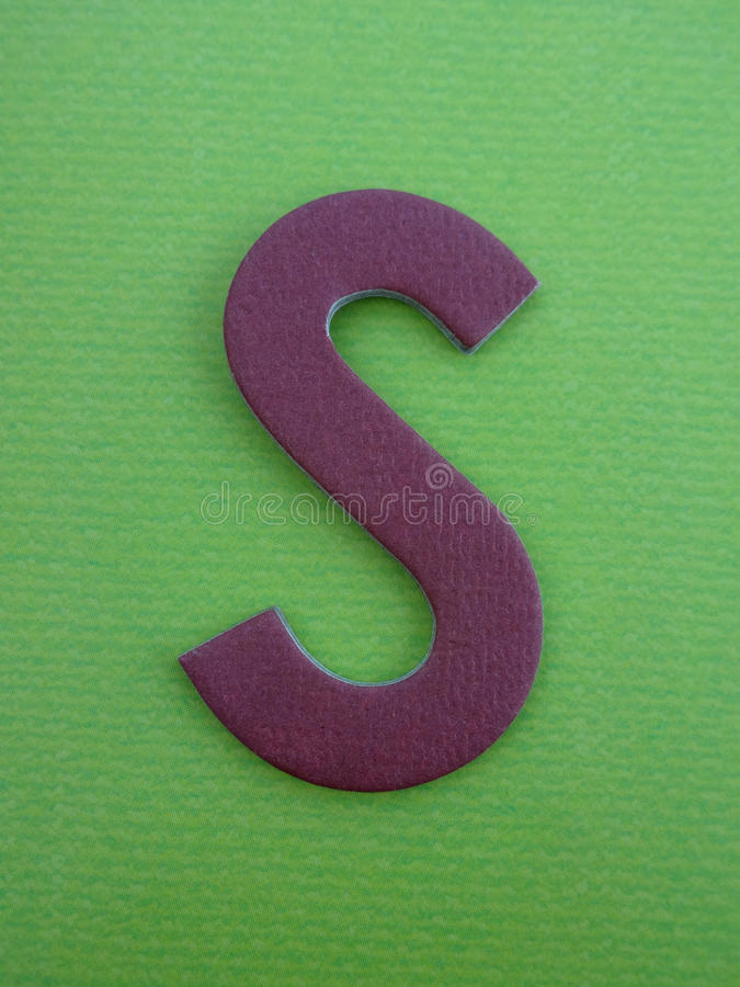 Alphabet Letter S. Purple Letter S on a Green Background stock photo
