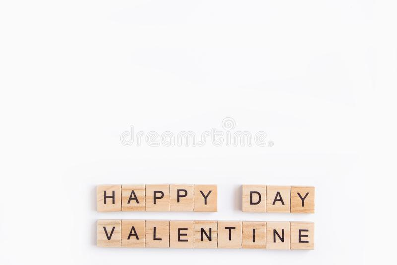 Alphabet letter wooden blocks tiles Valentine`s day on white background, Valentine concept, copy space.  stock image