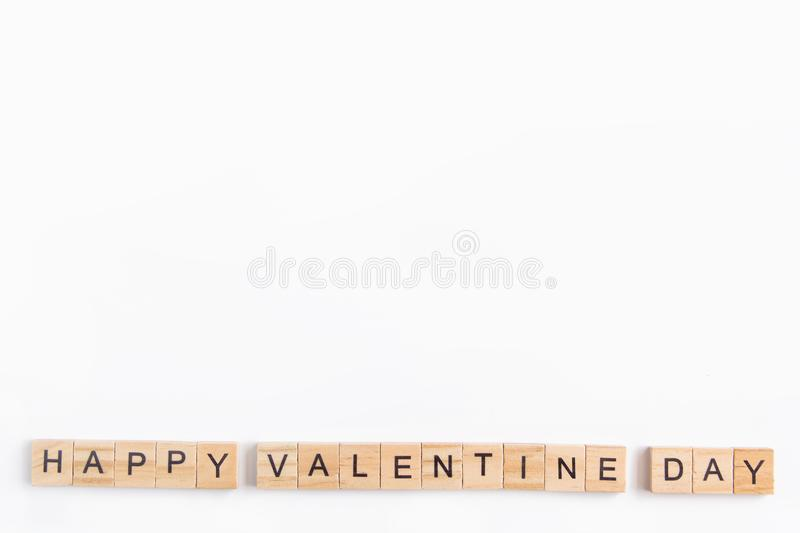 Alphabet letter wooden blocks tiles Valentine`s day on white background, Valentine concept, copy space.  stock photography