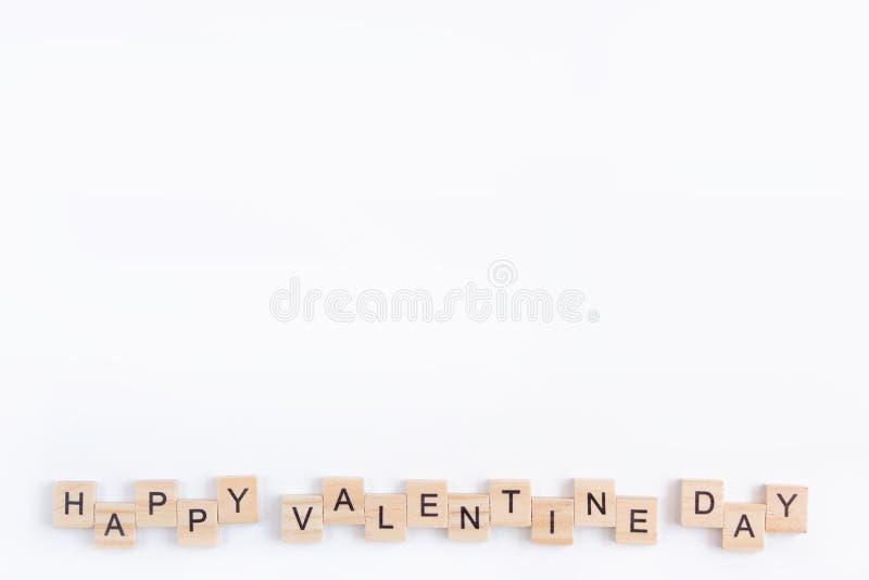 Alphabet letter wooden blocks tiles Valentine`s day on white background, Valentine concept, copy space.  stock images