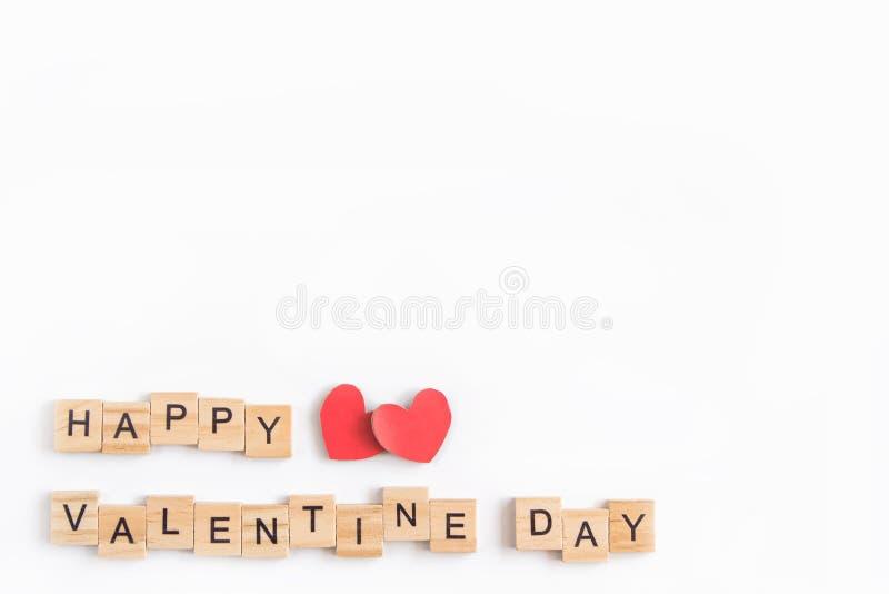 Alphabet letter wooden blocks tiles Valentine`s day on white background, Valentine concept, copy space.  stock photo