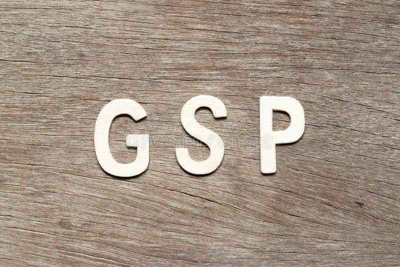 Alphabet letter in word GSP Abbreviation of Good Storage Practice or Generalized System of Preferences or Gross State Product. On wood background stock photo