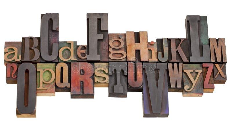Alphabet in letterpress printing blocks royalty free stock image