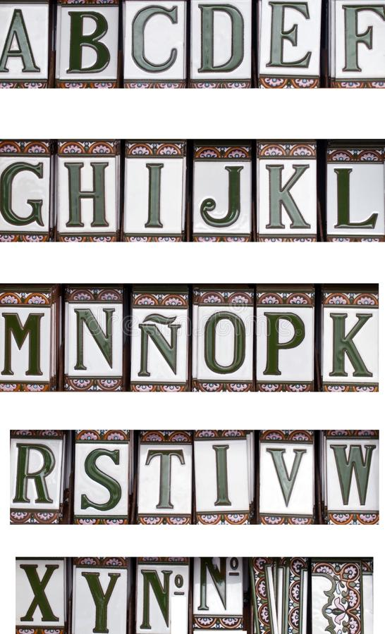 Alphabet letters. Ceramic alphabet letters arranged in order on a white background stock photo