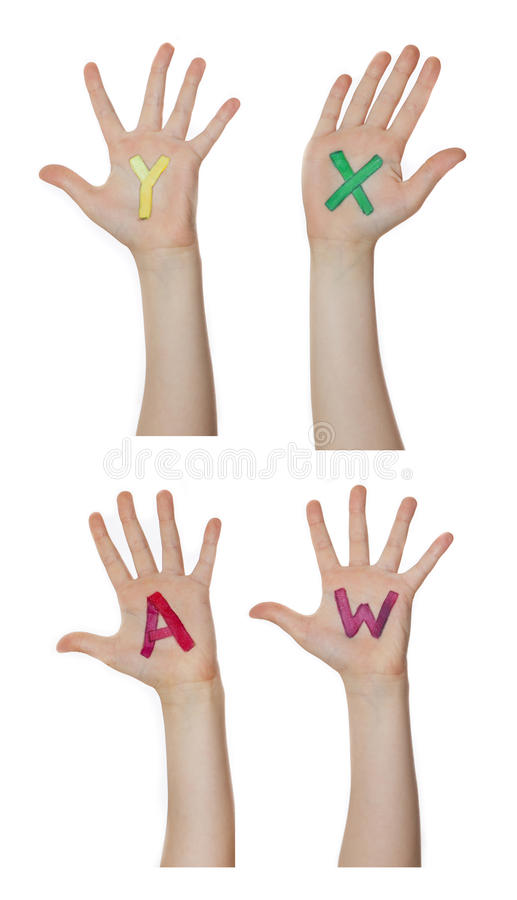 Alphabet (letters) painted on children hands. Rises up hands. Alphabet (letters) painted on children hands. Rises up hands royalty free stock photography