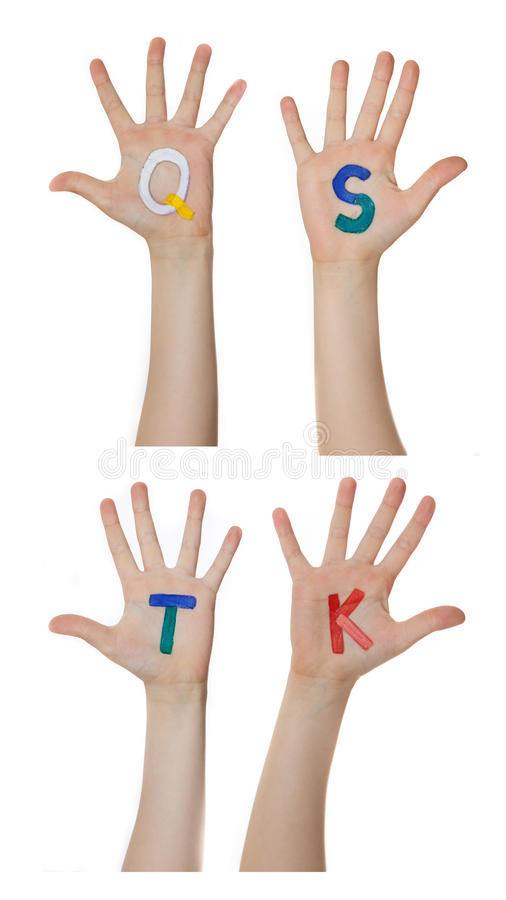 Alphabet (letters) painted on children hands. Rises up hands. Alphabet (letters) painted on children hands. Rises up hands royalty free stock photo
