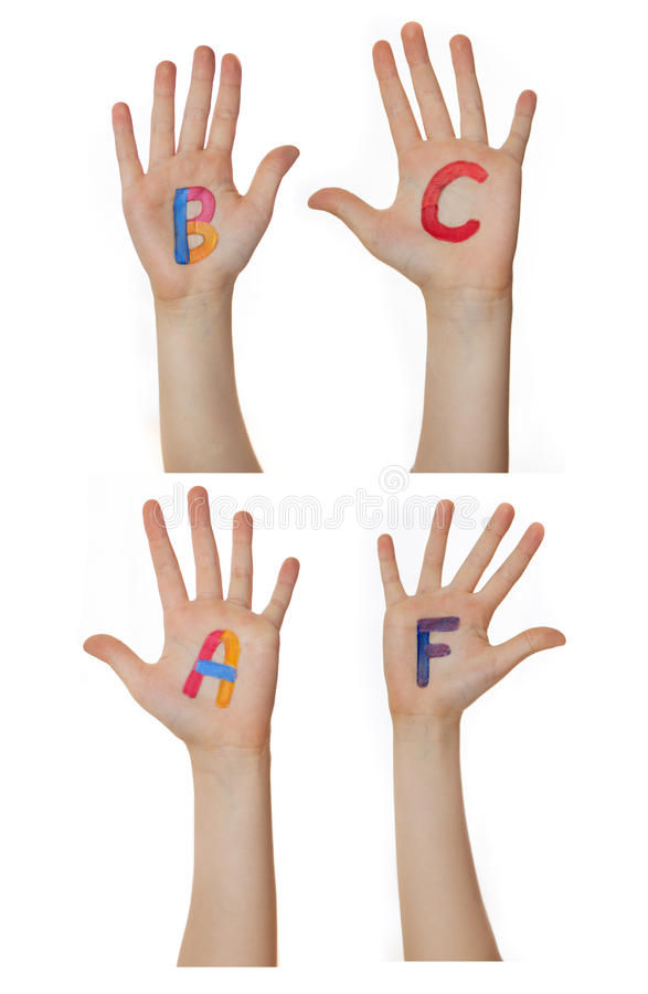 Alphabet (letters) painted on children hands. Rises up hands. Alphabet (letters) painted on children hands. Rises up hands stock photography