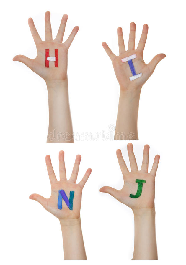 Alphabet (letters) painted on children hands. Rises up hands. Alphabet (letters) painted on children hands. Rises up hands royalty free stock photos