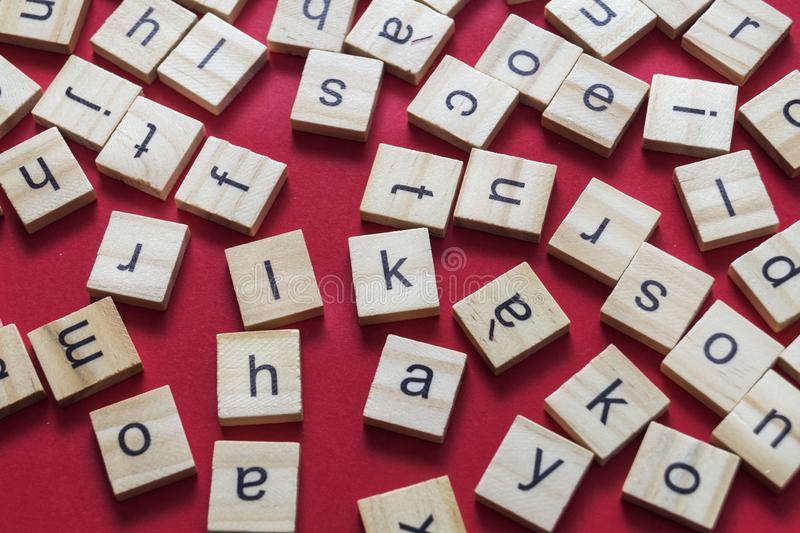 Alphabet letters on wooden scrabble pieces. From above royalty free stock photo