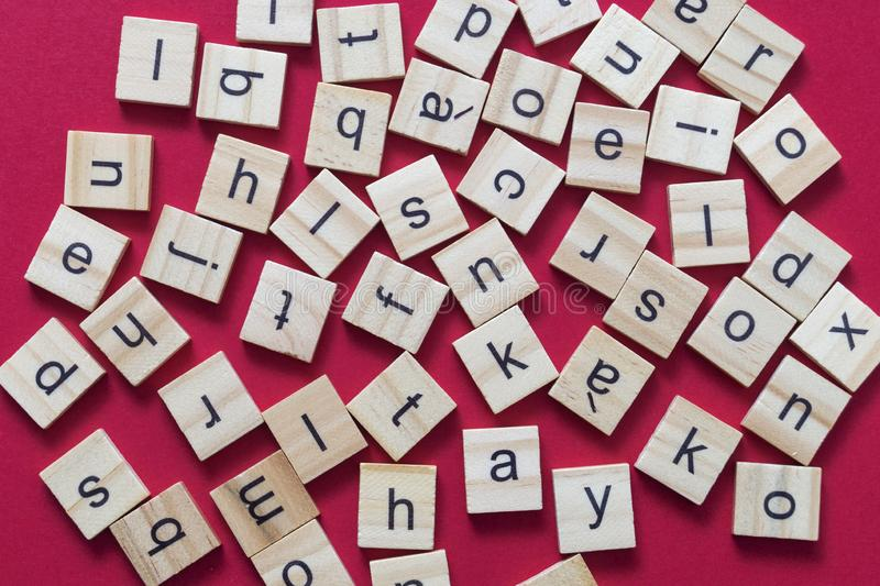 Alphabet letters on wooden scrabble pieces. From above royalty free stock images
