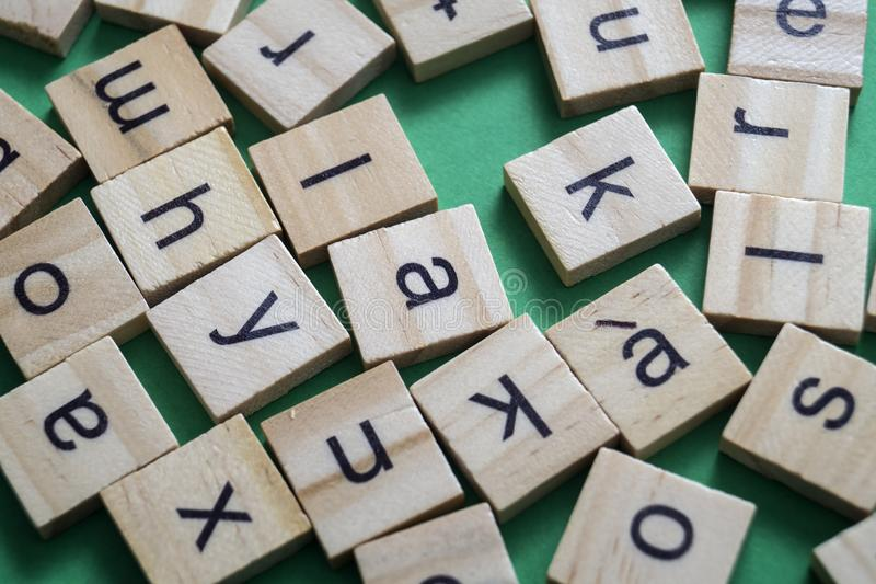 Alphabet letters on wooden scrabble pieces. From above stock photography