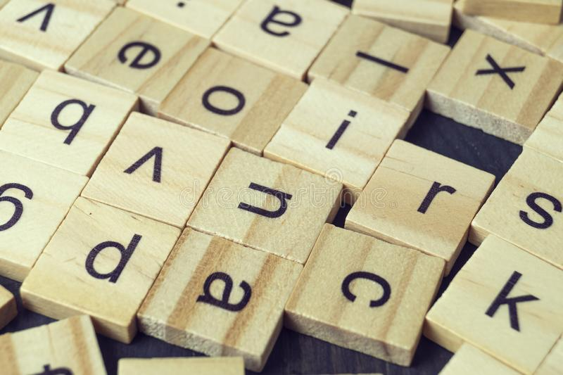 Alphabet letters on wooden scrabble pieces. Close up royalty free stock image