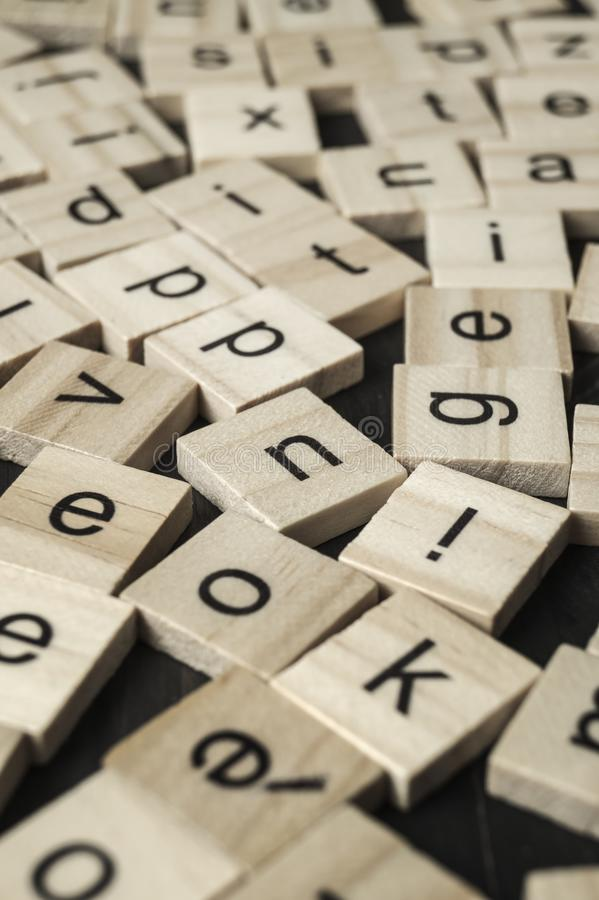 Alphabet letters on wooden scrabble pieces. Close up royalty free stock images