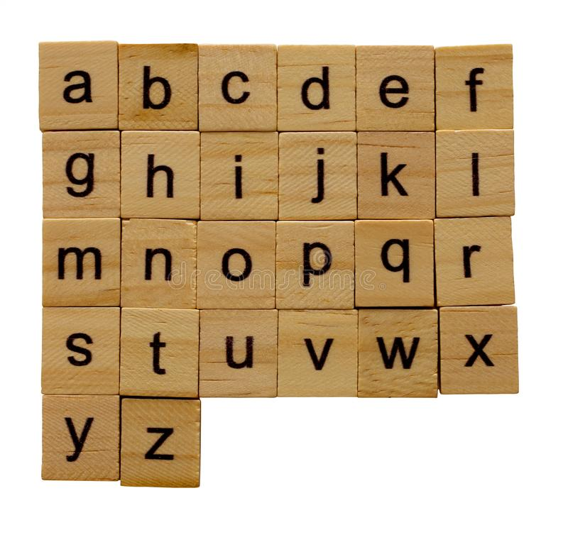 Alphabet letters a-z on wooden scrabble pieces, isolated on white background with clipping path royalty free stock photo