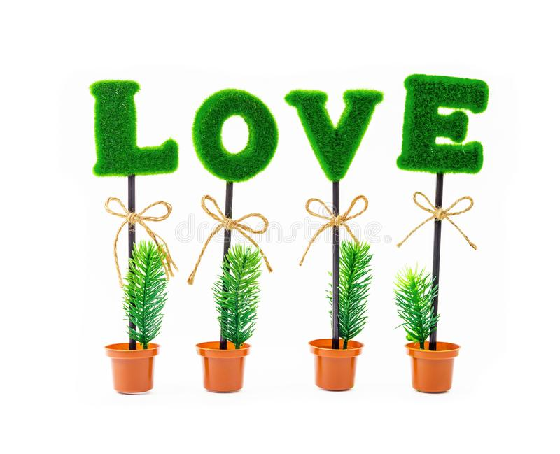 Alphabet of love in artificial tree. Alphabet of love in artificial tree isolated on white background stock photos