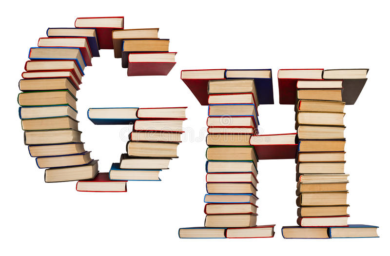 Alphabet made out of books, letters G and H. Alphabet made out of old books, letters G and H royalty free stock image