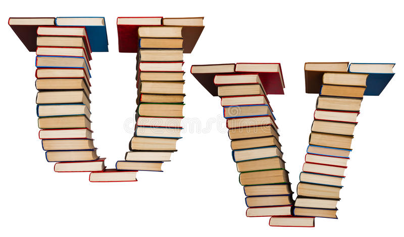 Alphabet made out of books, letters U and V. Alphabet made out of old books, letters U and V royalty free stock photography