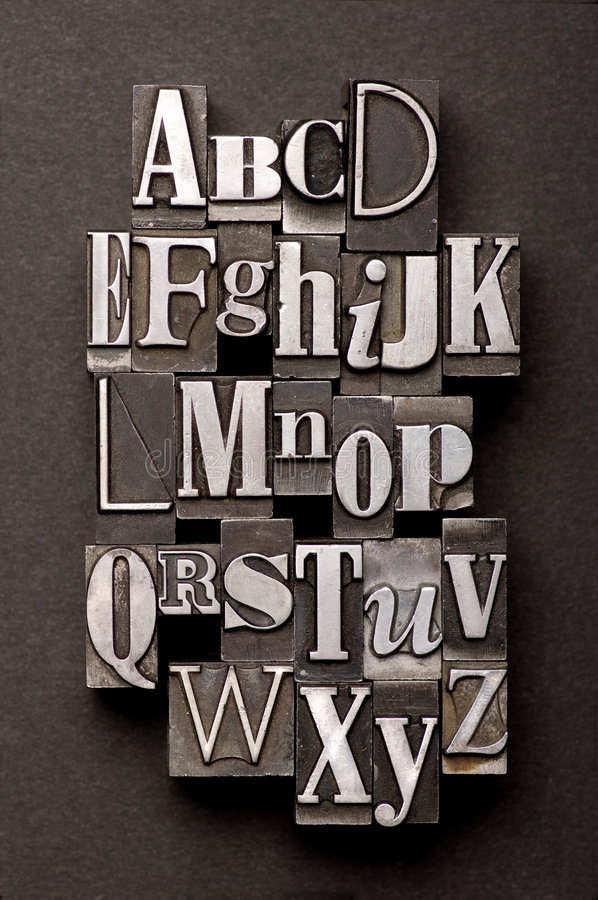 Alphabet Mix. Alphabet photographed using a mix of vintage letterpress characters on a black textured background