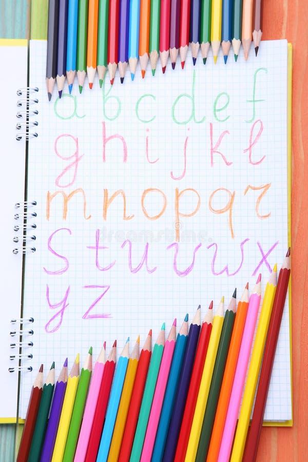 alphabet in notebook stock image