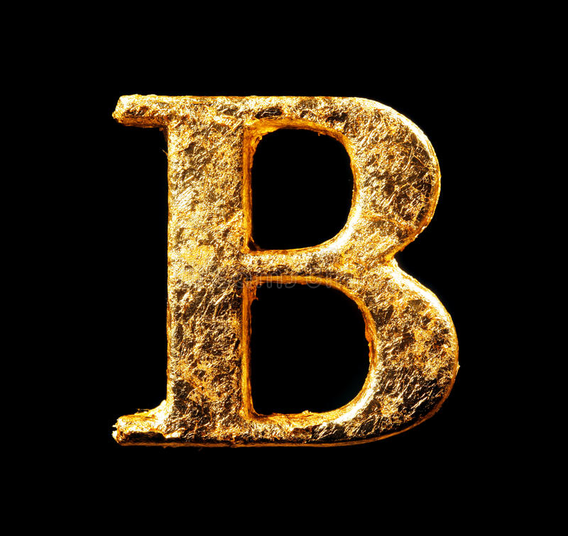Alphabet and numbers in gold leaf stock image