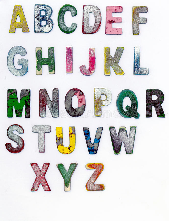 Alphabet,. Painted scratched color wooden alphabet royalty free stock image