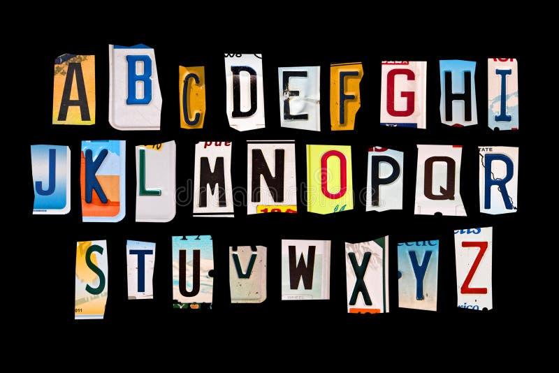 Alphabet set with broken pieces of vintage car license plates stock photo