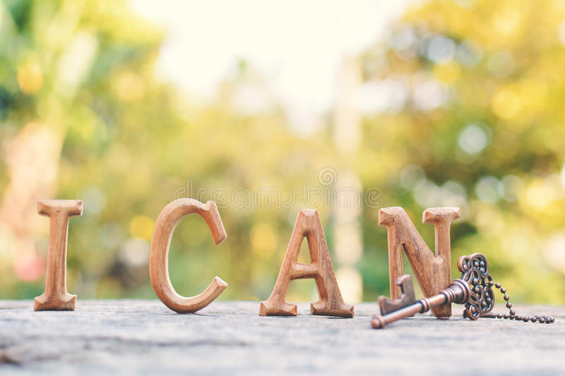 Alphabet wood. `I can` word on tree bokeh background, selective and soft focus stock photo